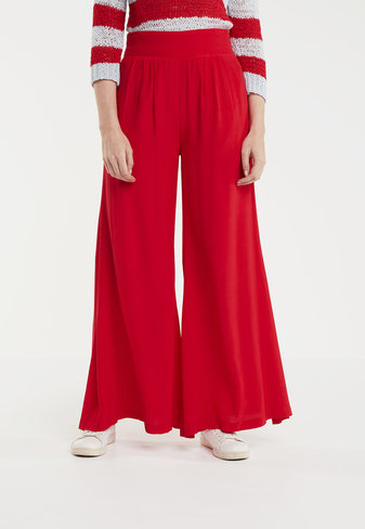 Flared trousers in classic red